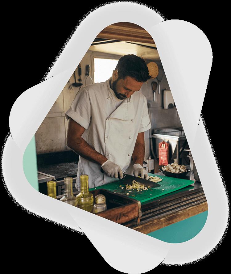 male business owner preparing food in food truck
